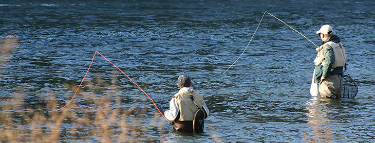 Two men fly fishing