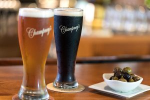 Two glasses of Champney's beer and a dish of olives