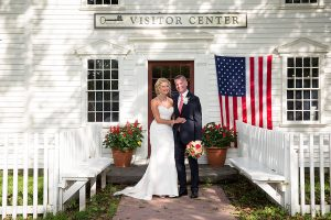 Bride and groom in front of Visitor Center building