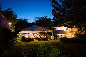 Outdoor wedding reception at night