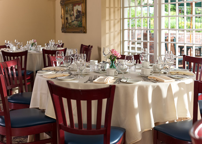 Dining tables set for a meal