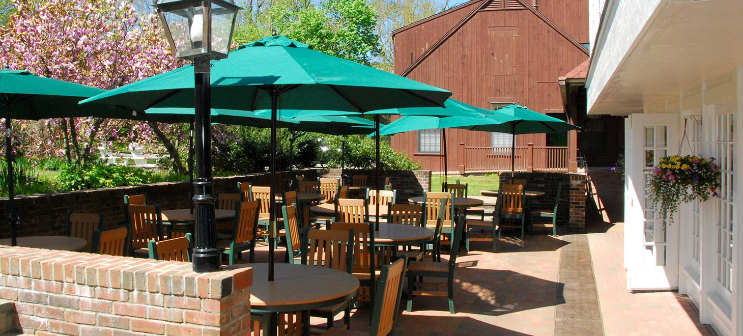 Patio tables with umbrellas