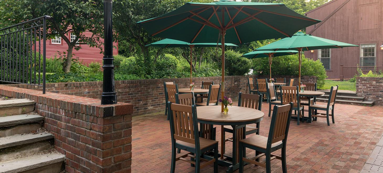 Patio tables with umbrellas