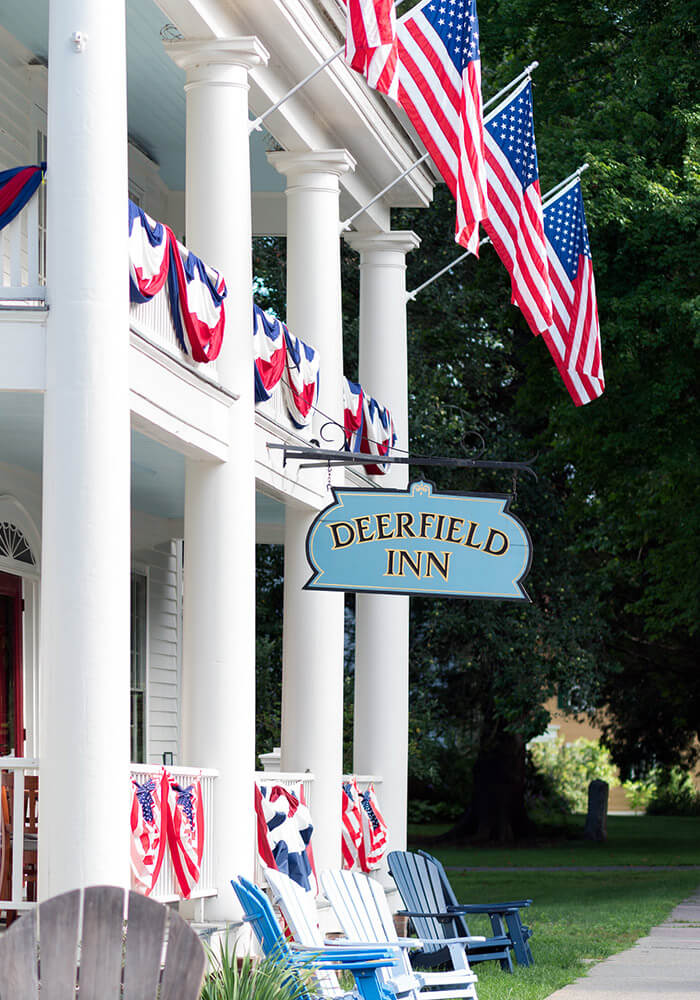 Deerfield Inn front with sign and flags