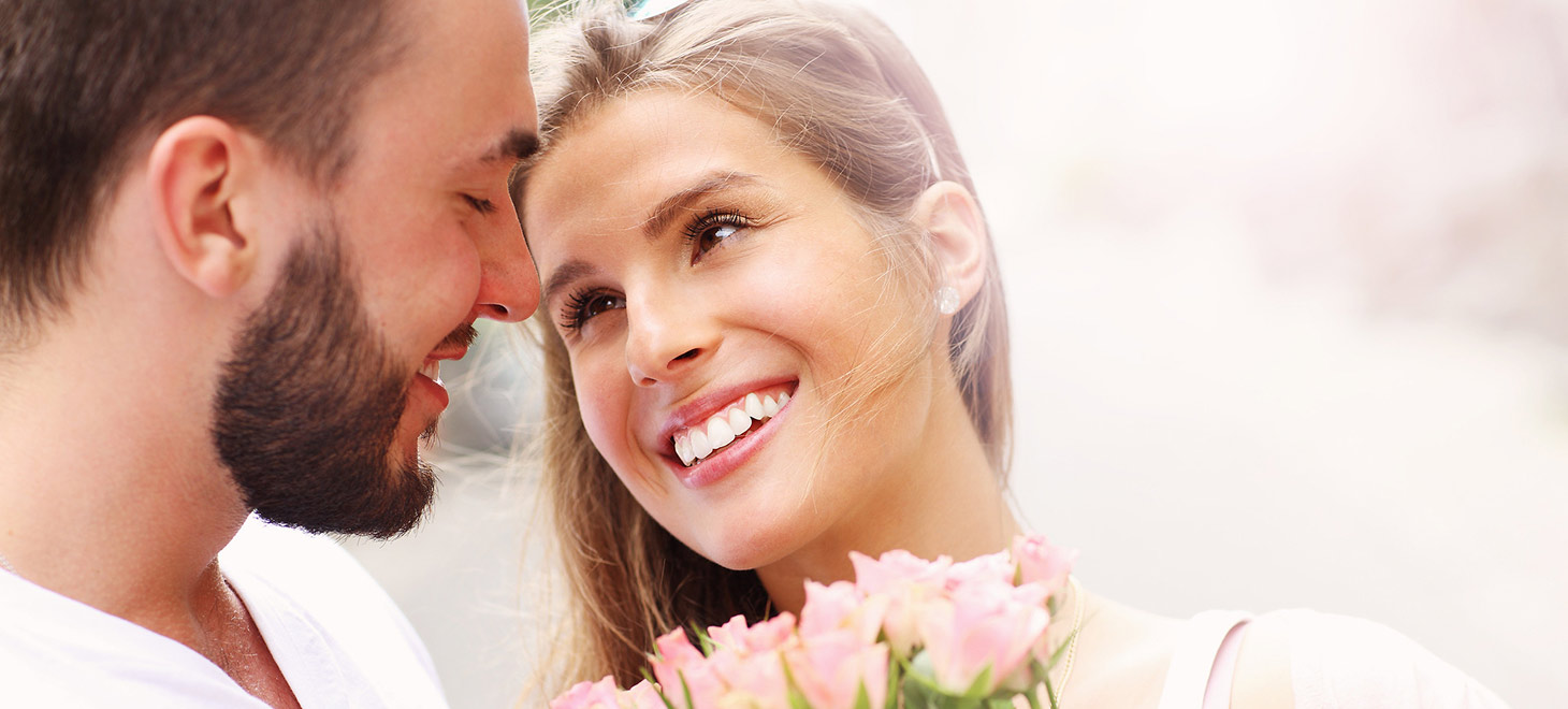 Romantic couple with girl holding flowers
