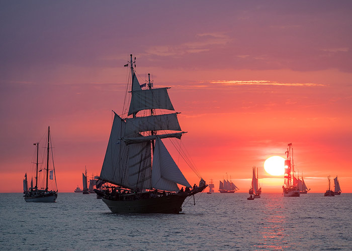 Ships on the sea at sunset