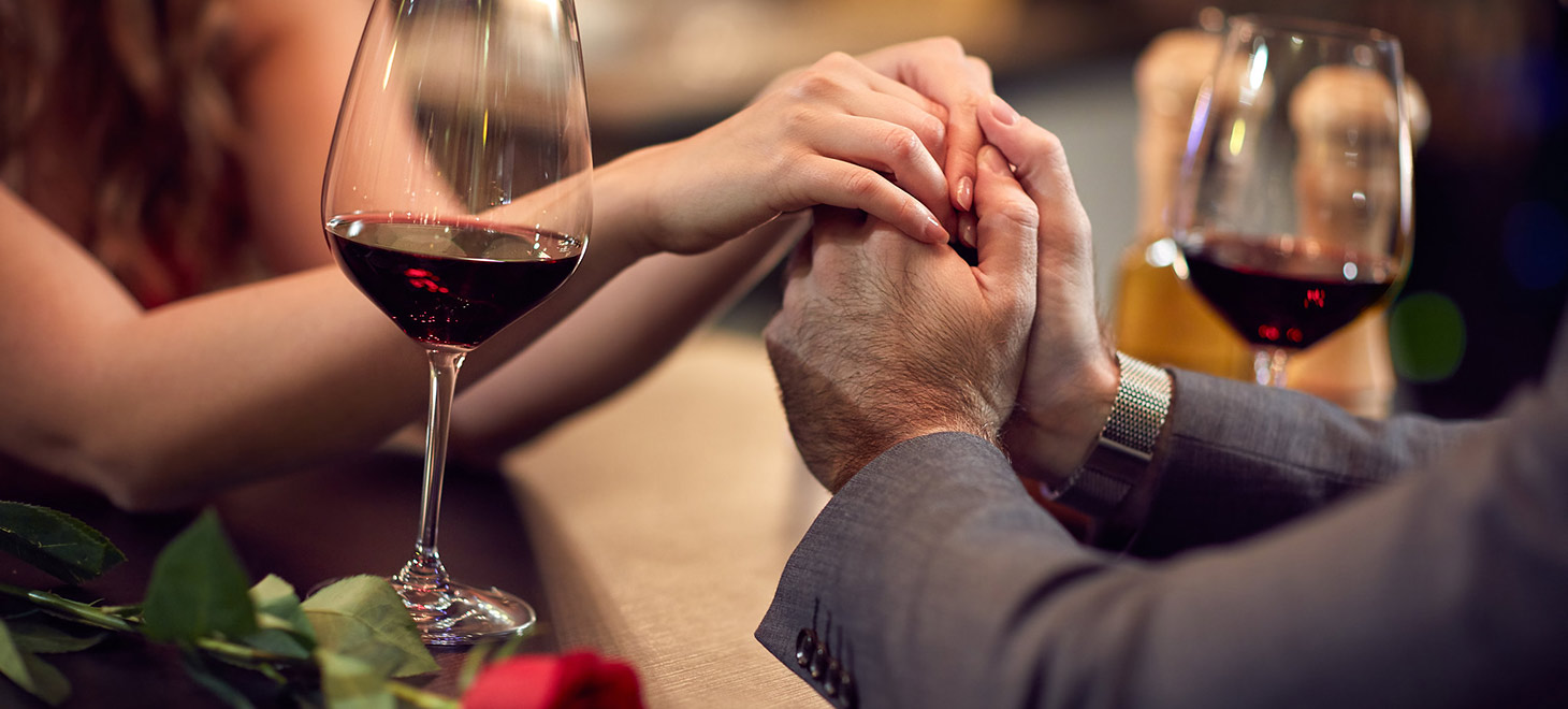 Couple holding hands at a romantic dinner