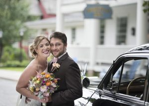 Bride and groom in front of the Deerfield Inn