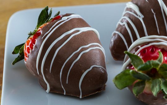 Chocolate covered strawberry with white chocolate drizzle