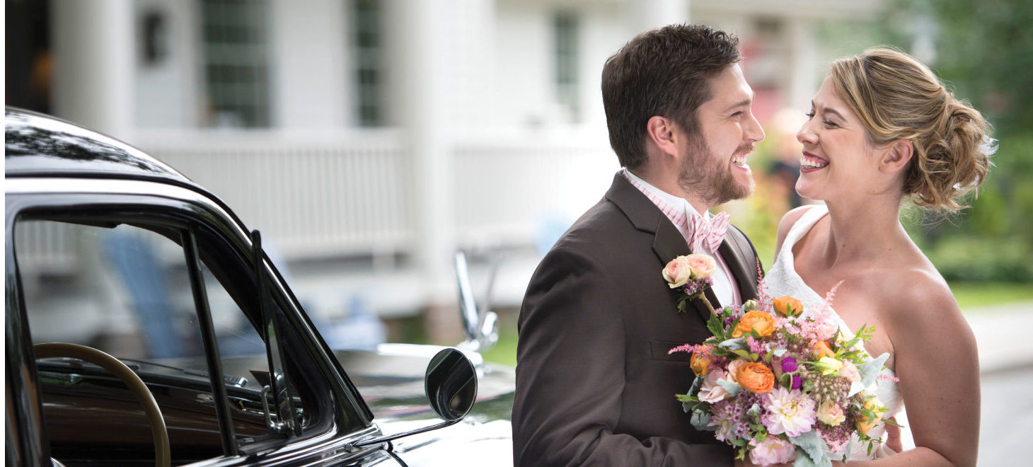 Wedding Couple smiling at each other after getting married